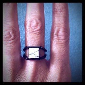 Split shank black ring with marble stone